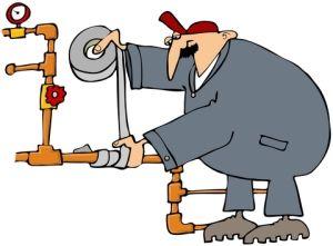 plumber taping a pipe